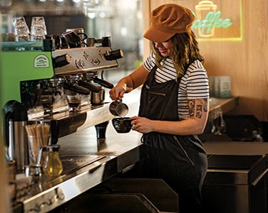 Barista pours handcrafted Chameleon coffee