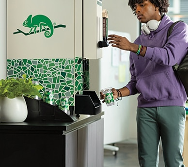 Man uses Chameleon Organic Coffee machine in high end apartment