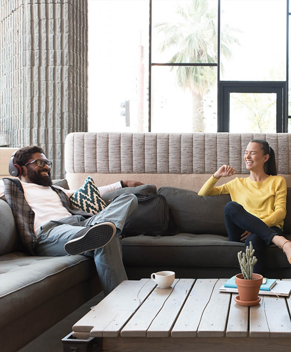 Man and woman enjoying coffee in residential property