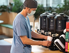 doctor pours cup of hospital coffee
