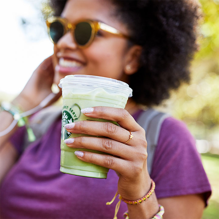 woman drinking Starbucks iced matcha